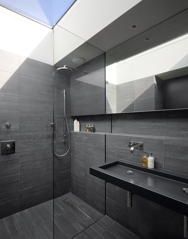 15 bold and beautiful black bathroom design ideas for Bathroom ideas black tiles